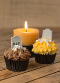 Halloween cupcakes and a burning candle close up — Photo