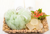 Shower puff and soaps in banana leaf basket close up — Stock Photo