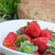 Strawberries in a bowl in the garden — Stock Photo #39036761