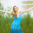 Beautiful woman on tree and water natural background, happy smile woman — Stock Photo #12129488