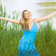 Beautiful woman on tree and water natural background, happy smile woman — Stock Photo