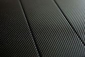 Black metal texture background with lattice pattern, light gradient and sma — Stock Photo