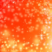Christmas lights on red background with delicate stars, snowflakes, sparkles and bokeh bubbles — Stock Photo