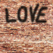 Red brick wall texture and shadow painted love text as valentine day background — Stock Photo