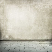 Old wall and brick floor or pavement — Stock Photo