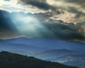Dramatic storm clouds over the mountains — Stock Photo