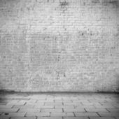 Grunge background white brick wall texture and blocks road sidewalk abandoned building exterior urban background for your concept or project — Stock Photo