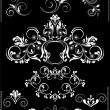 Stock Vector: Collection white flourishes patterns   on black background