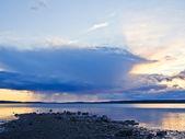 Rain on sunset on the sea. — Stock Photo