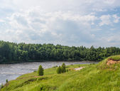 Landscape with the rough river — Stock Photo