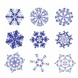 Royalty-Free Stock Vector Image: Set of blue snowflakes on a white background.
