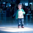Cute little boy standing at airport — Stock Photo #12455587