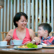 Mother and son having lunch together at the mall — Stok fotoğraf