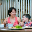 Mother and son having lunch together at the mall - Stock Photo
