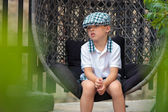 Portrait of a little boy outdoors in city — Stock Photo
