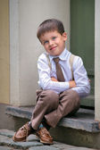 Portrait of a happy little boy outdoors in city — Stock Photo