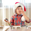 Little boy baking Christmas cookies — Stock Photo