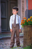 Portrait of a cute little boy outdoors in city — Stock Photo