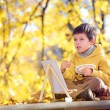 Cute little boy painting with brush — Stock Photo #14131954