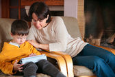 Mother and son playing on digital tablet PC — Stock Photo