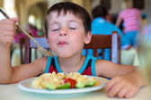 Cute little boy enjoying food — Stok fotoğraf