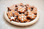 Plate of christmas cookies with festive decoration — Stock Photo