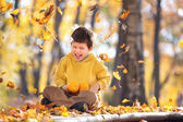 Cute five years old boy having fun in autumn park — Stock Photo