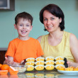 Mother and little son presenting their muffins — Stock Photo #14656035
