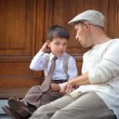 Royalty-Free Stock Photo: Happy father and son relaxing outdoors in city