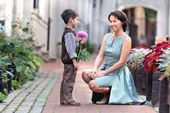 Little son giving a flower to mother — Stock Photo