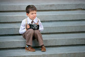 Cute little boy with retro camera outdoors — Stock Photo