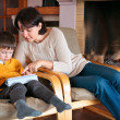 Mother and son playing on digital tablet PC — Stock Photo #14943477