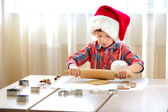 Little boy with rolling pins baking and having fun — Stock Photo