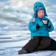 Cute little boy drinking hot tea in winter — Stock Photo