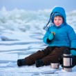 Little boy having a picnic on winter vacation — Stock Photo