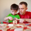 Happy family. Father and son working at home — Stock Photo