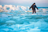 Man walking on icy beach along the Baltic sea — Stock Photo