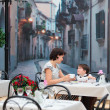 Mother and son sitting in cafe — Stock Photo #20500845