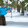 Cute five years old boy playing on winter forest — Stock Photo