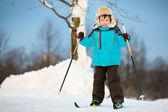 Happy little boy skiing on cross — Stock Photo