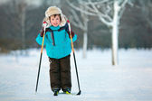 Cute five years old boy skiing on cross — Stock Photo