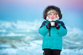 Cute five years old boy drinking hot tea in winter — Stock Photo