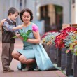 Little boy giving flower to his mom — Stock Photo #21865039
