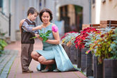 Little boy giving flower to his mom — Stock Photo