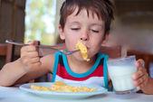 Cute little boy having delicious breakfast — Stock Photo