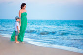 Mother and her little son enjoying beach — Stock Photo