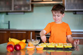 Little boy helping with baking cookies — Stock Photo