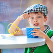 Cute little boy eating ice cream at indoor cafe — Stock Photo