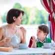 Mother and son having breakfast together — Stock Photo #24331573