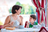 Mother and son having breakfast together — Stock Photo